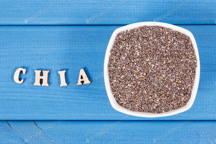 Inscription chia and seeds in bowl, concept of food containing natural vitamins, fiber and minerals
