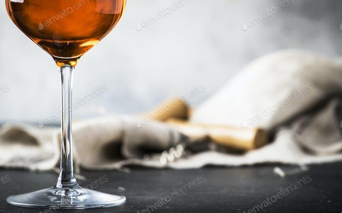 Orange wine in big wine glass, fashionable modern drink