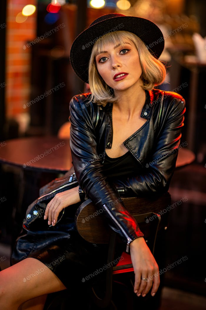 Be young every night. Beautiful mysterious woman exploring night city alone
