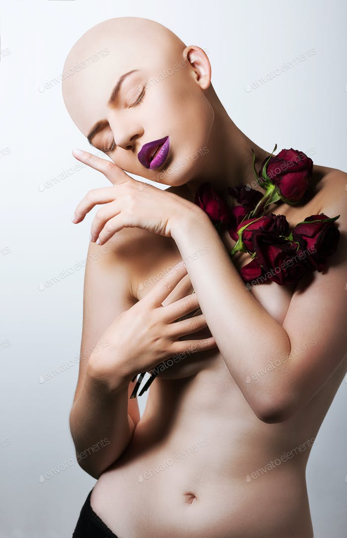 Inspiration. Stylish Bald Woman with Flowers