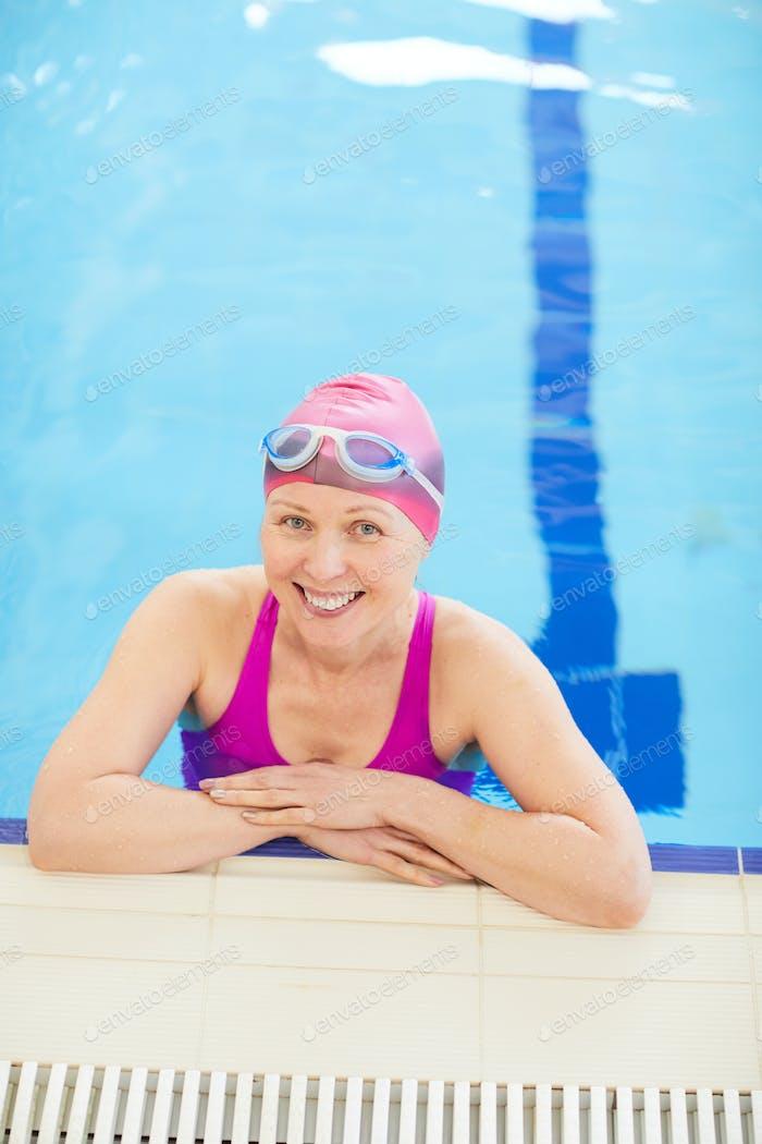 Happy Mature Woman Posing in Pool