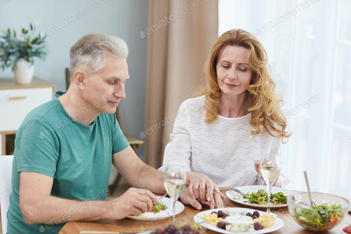 Mature Married Couple at Dinner Table