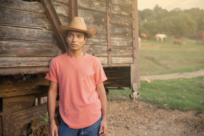 Placeit - Portrait of Young Man Wearing Jeans and a Cowboy Hat Posing
