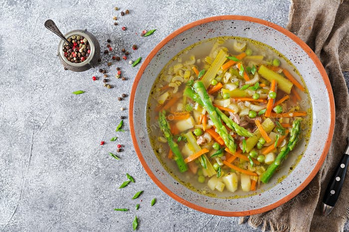 Soup with beef, asparagus, green peas, carrots and celery. Dietary menu.