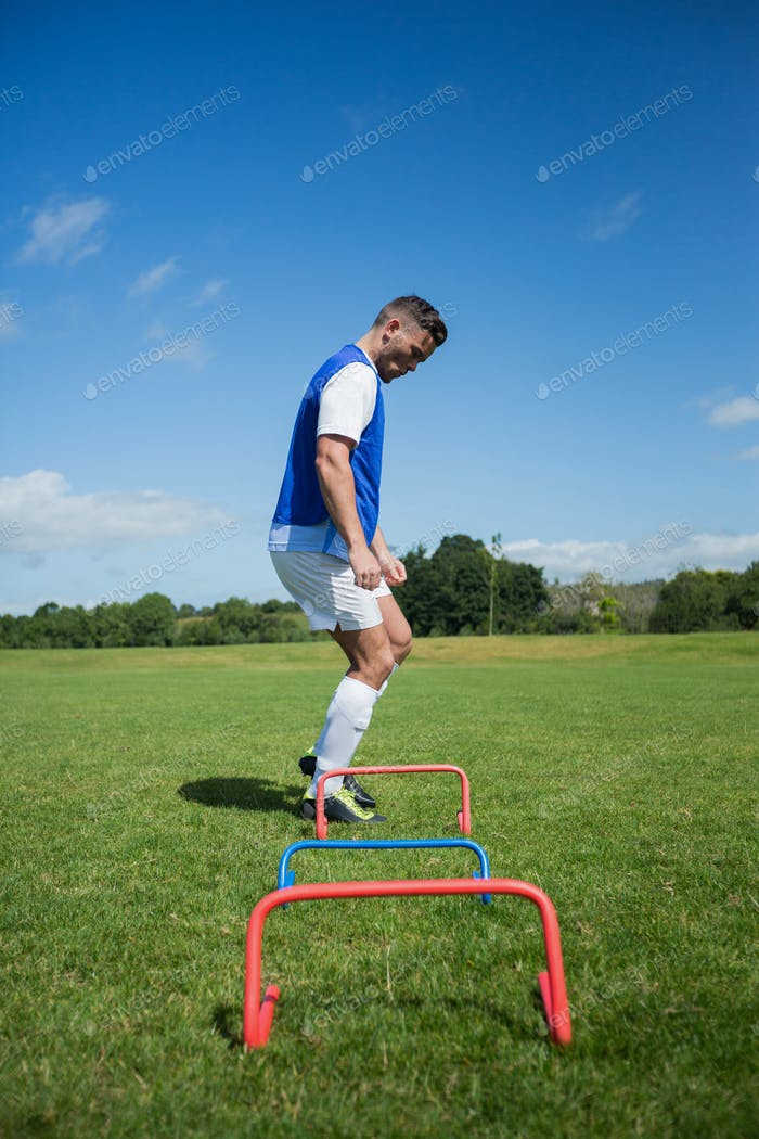 Thumbnail for Soccer player practicing on obstacle