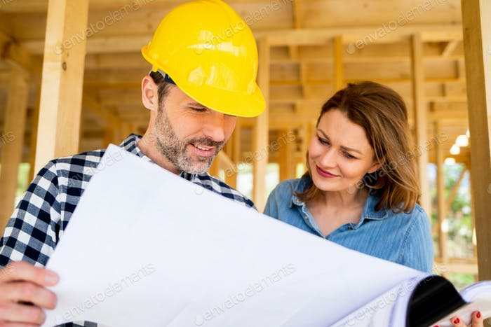 Female investor meeting with architect or engineer on construction site