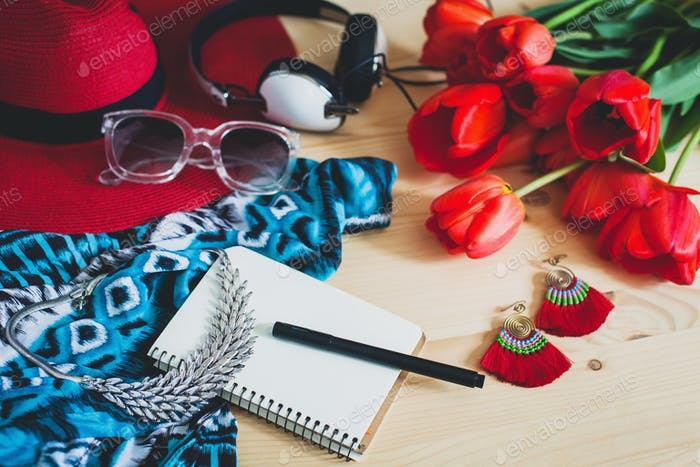 woman's accessories flat lay with red tulips