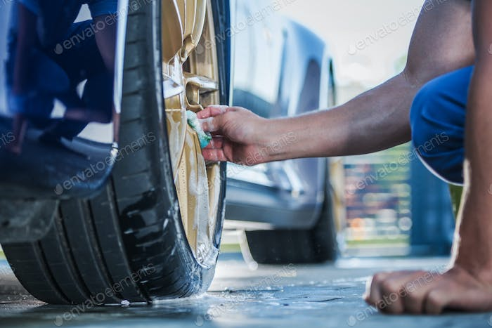 Cleaning Exotic Car Golden Alloy Wheels