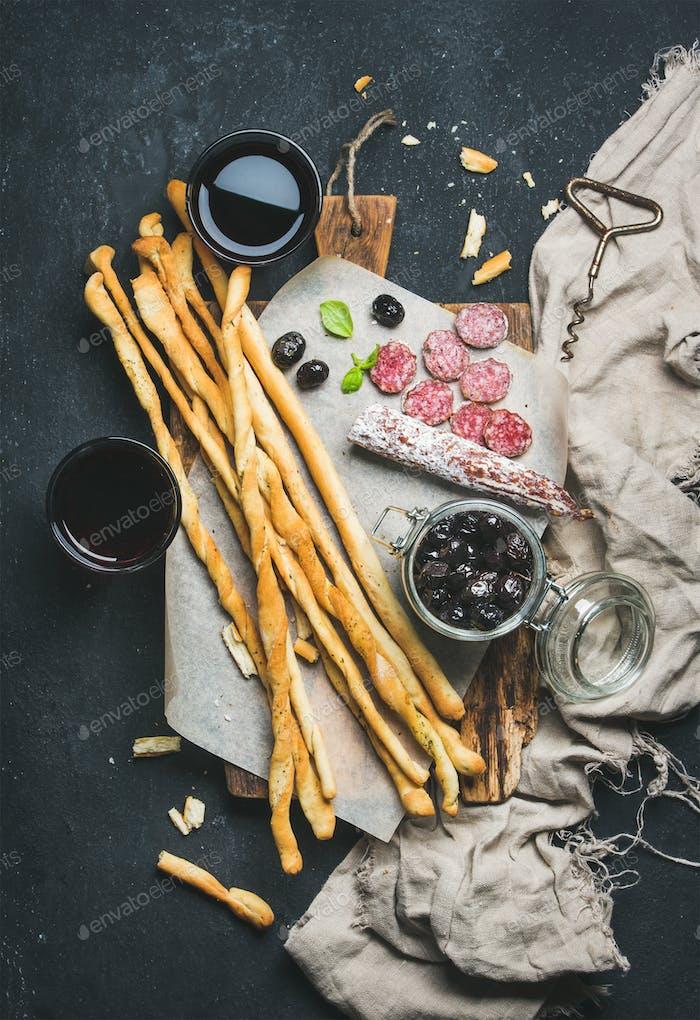 Italian Grissini bread sticks, dry cured pork sausage, red wine