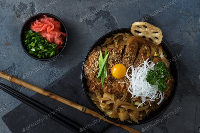 Katsudon rice topped with fried pork, japanese cuisine