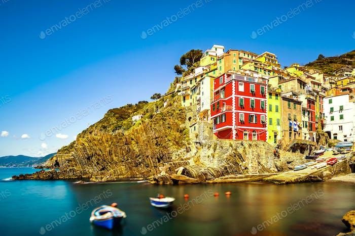 Riomaggiore village, rocks and sea at sunset. Cinque Terre, Ligu