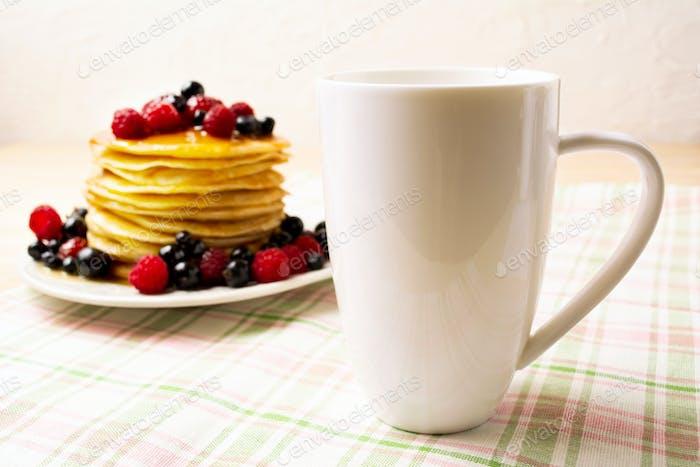 White coffee cappuccino mug mockup with pancakes and berries