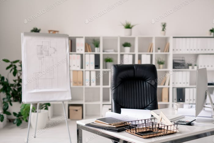 Workplace of architect or office manager on background of shelves with documents