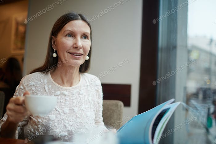 Retired female in cafe