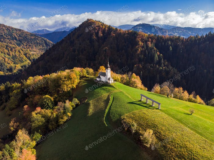 Aerial view of rural church or chapel in Slovenia at autumn