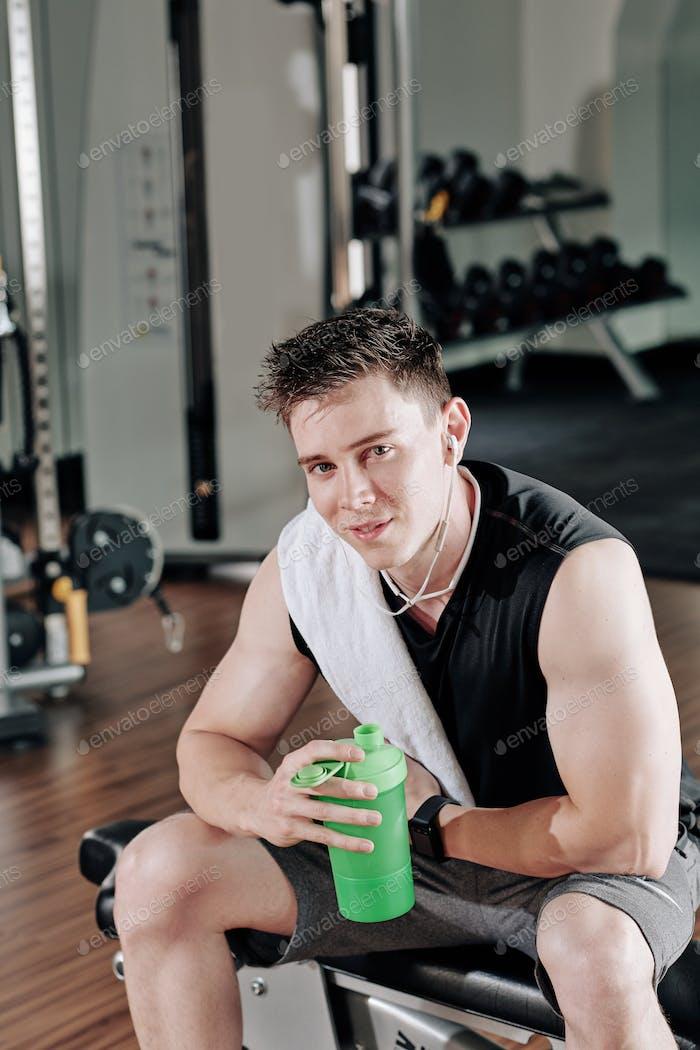 Sportsman drinking shake