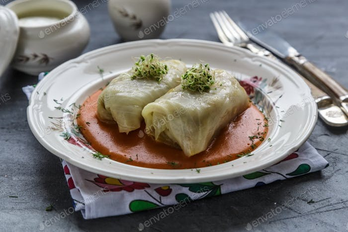 Cabbage roll, golubtsi in ceramic bowl on dark background, traditional Ukrainian cuisine