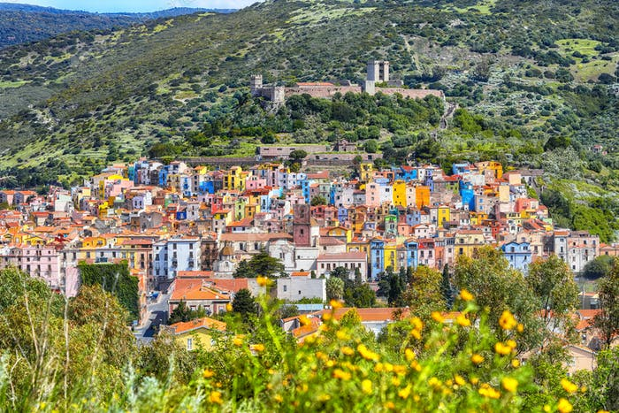 Wonderful morning panorama of colourful houses of old town Bosa in Sardinia