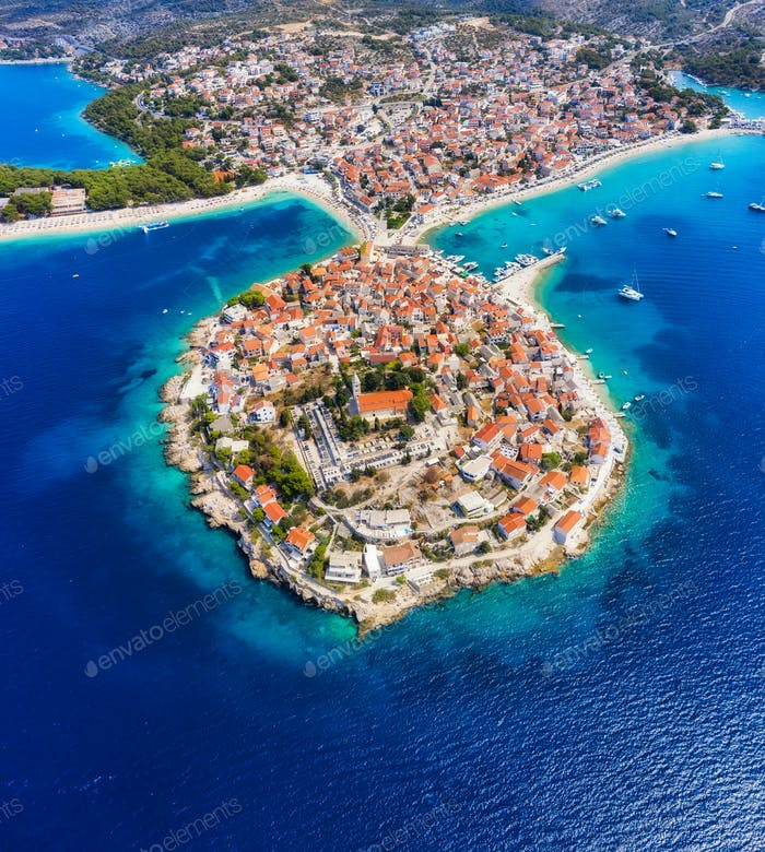 Primosten town, Croatia. View of the city from the air. Seascape with beach and old town.