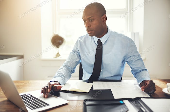 Young businessman working on a computer in an office