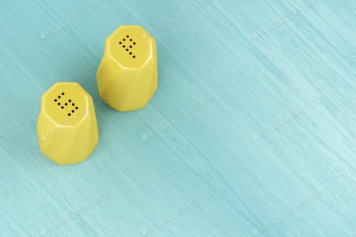 Yellow salt and pepper shakers