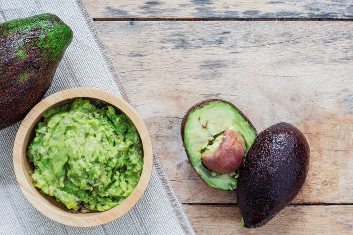 Grated avocado on wooden