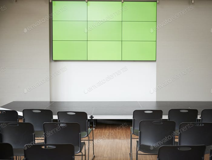 Empty Conference With Green Screen And Chairs Laid Out For Presentation