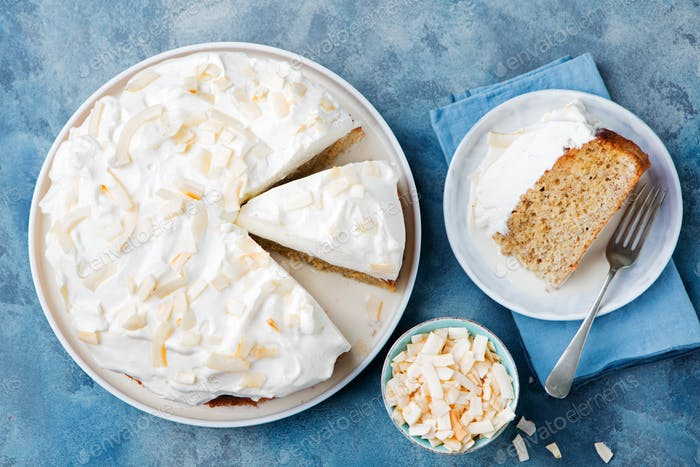 Three milk cake, tres leches cake with coconut. Traditional dessert of Latin America Top view