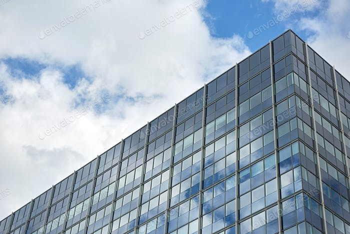 Office building reflecting the blue sky