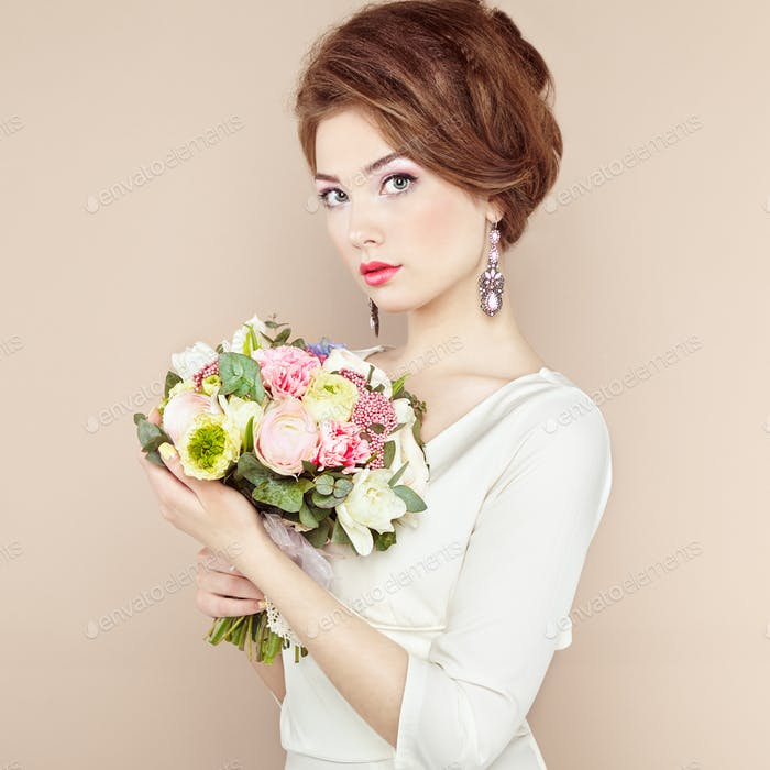 Woman with bouquet of flowers in her hands