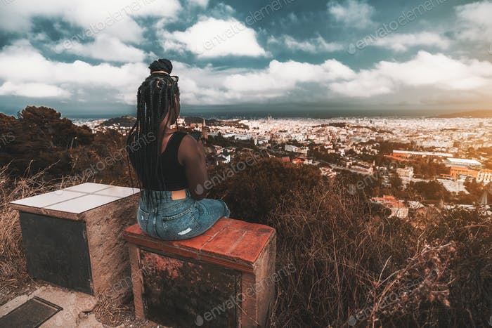 Black girl in front of cityscape
