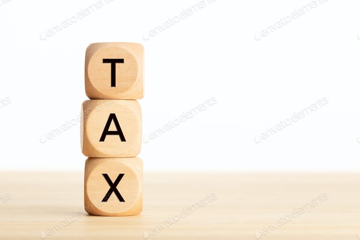 Tax word in wooden blocks on table