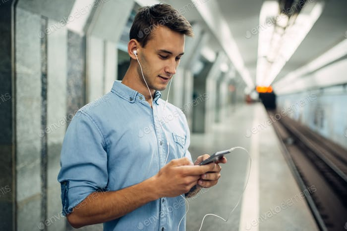 Phone addict man using gadget in subway