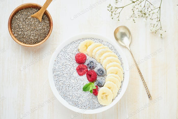 Chia pudding in bowl with fresh berries raspberries, blueberries