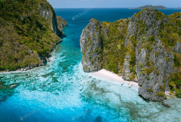 El Nido, Palawan, Philippines. Aerial view of tropical sea stack Island with tourist boats moored at