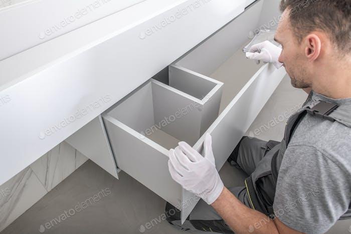 Furnishing Technician Finishing Custom Made Bathroom Furniture