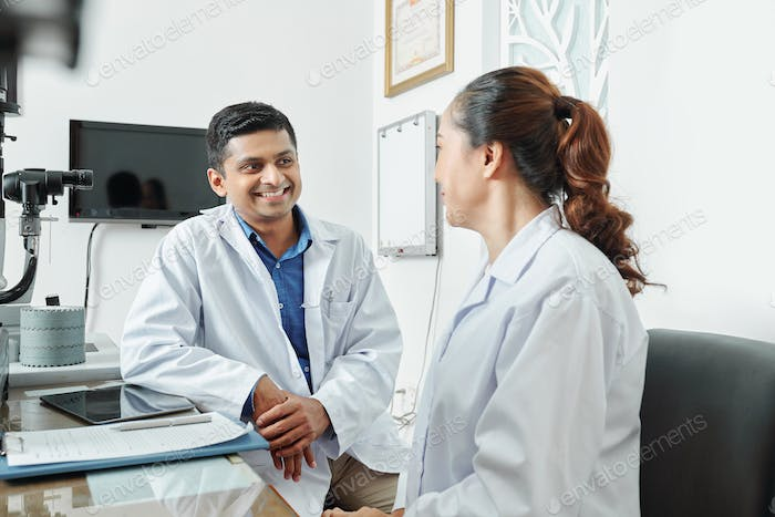 Two doctors talking at office