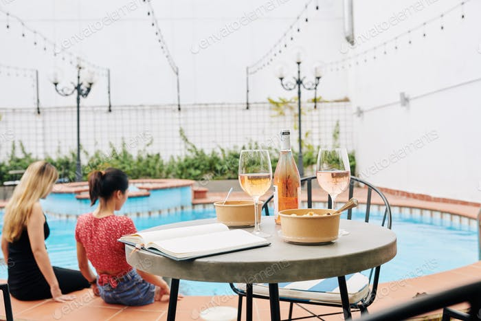 Cafe table at swimming pool