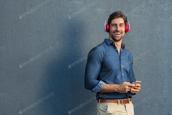 Man listening music with wireless headphones