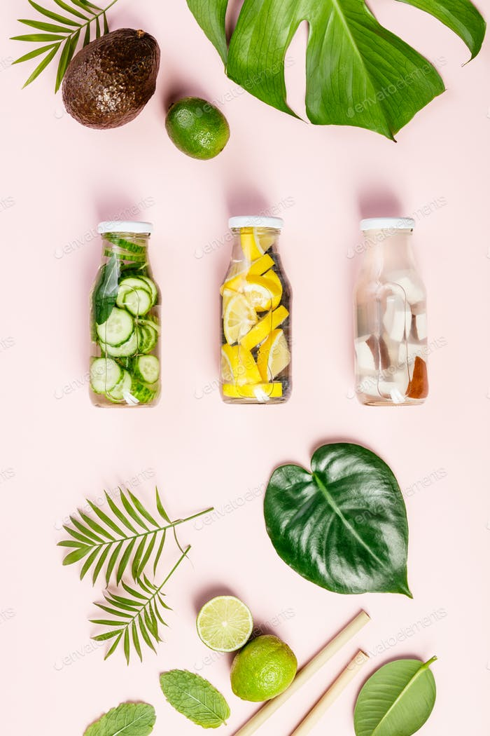 tropical fruits and leaves and infused water