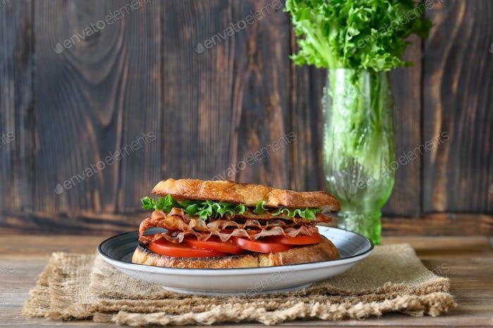 BLT sandwich on the wooden board
