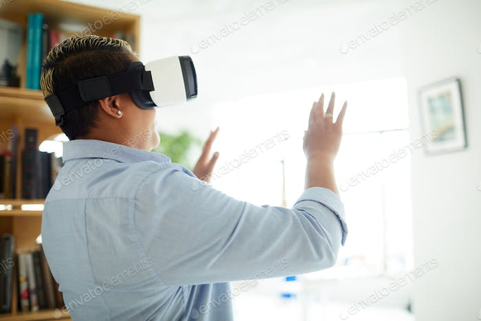 Black woman using VR device