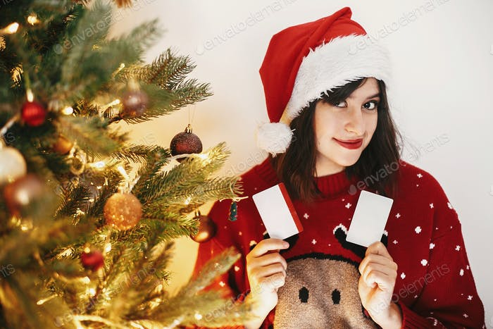 Girl holding two credit cards