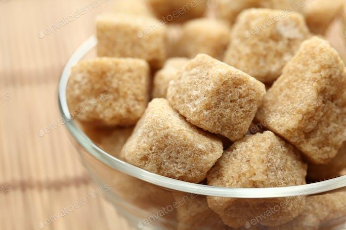 Brown cane sugar in a glass bowl