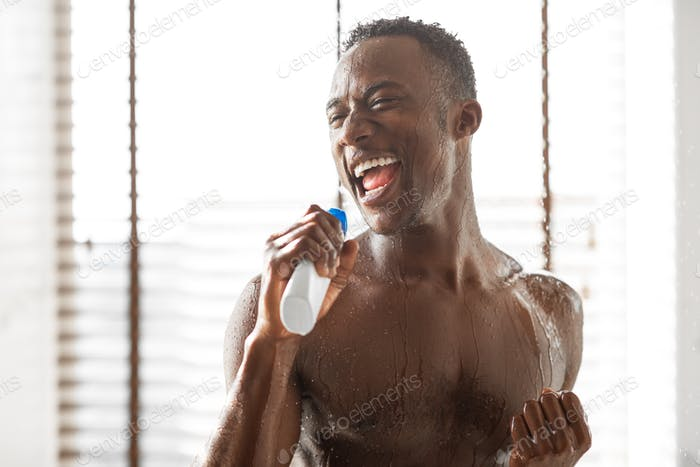 Naked African Guy Taking Shower And Singing Relaxing In Bathroom