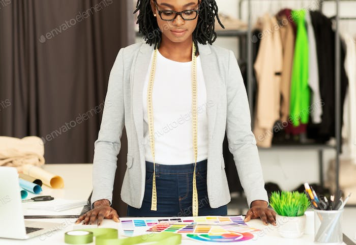 Clothing Designer Working With Color Samples In Fashion Studio