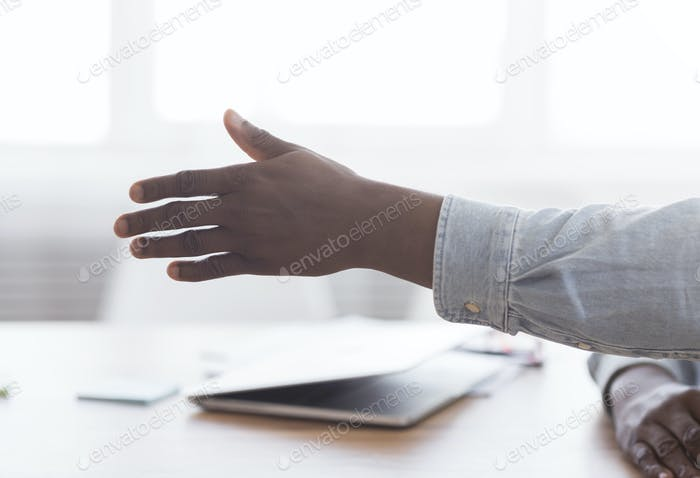 Hand of african american man extended for handshake