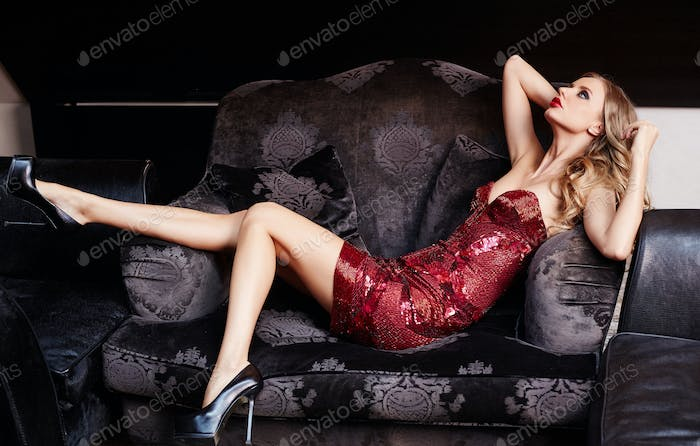 Sexy blond female in a red dress.