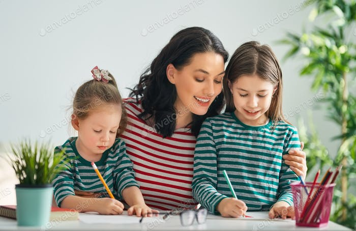 Mother and daughters drawing together