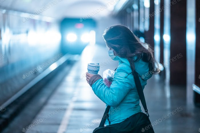 Woman wait at a subway station in Kiev